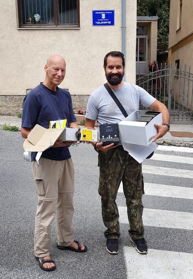 Igor Trbojevic of the University of Banja Luka (right) receives the ultrasound recorders and wildlife cameras.
